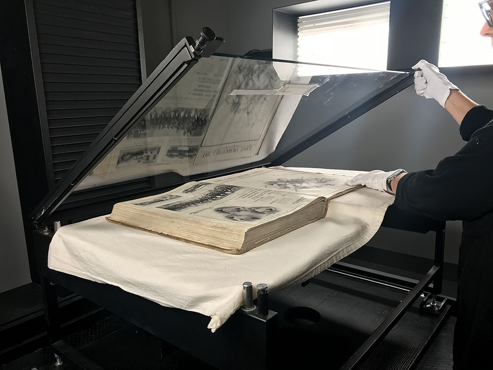 Handling heritage books_NZMS